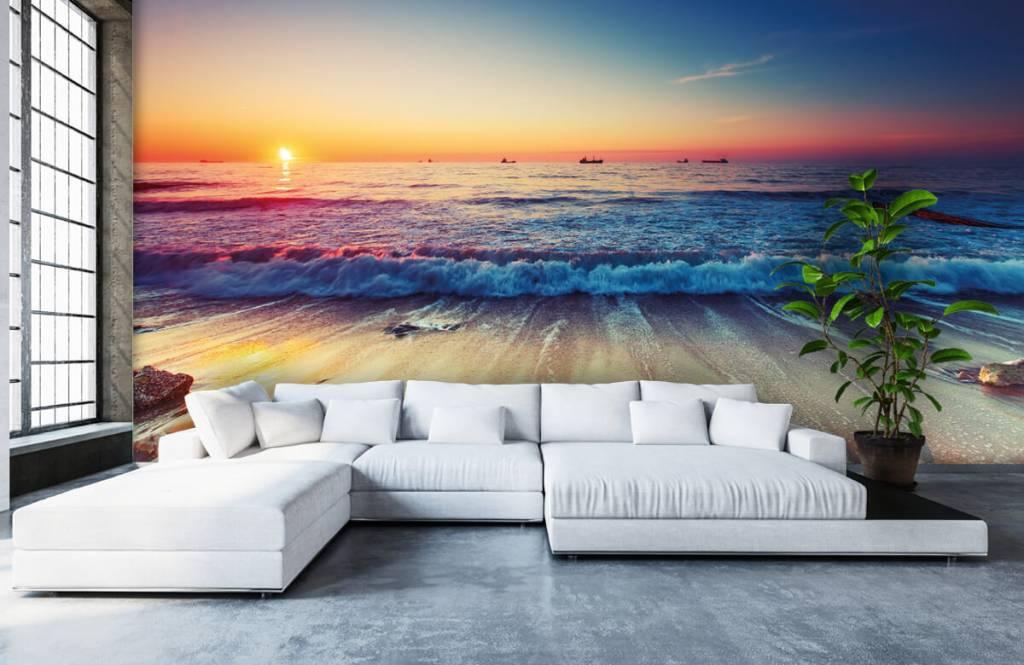 Fotobehang Strand Zee.Behang Met Een Zonsondergang Boven Zee Fotobehang